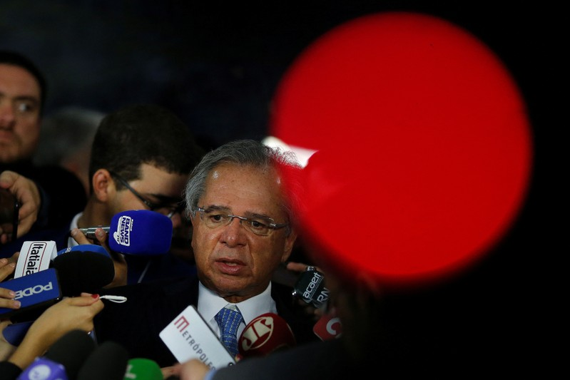 Brazil's Economy Minister Paulo Guedes speaks with journalists after meeting with Brazil's President Jair Bolsonaro at the National Congress, in Brasilia