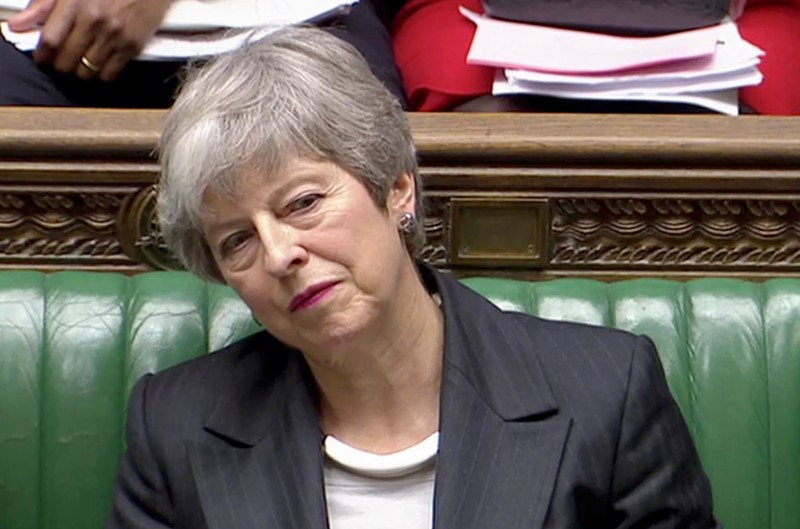 Britain's Prime Minister Theresa May listens in Parliament, in London