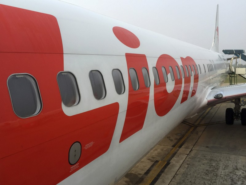 FILE PHOTO: A Lion Air jet sits on the tarmac of Tjilik Riwut Airport in Palangkaraya, central Kalimantan, Indonesia