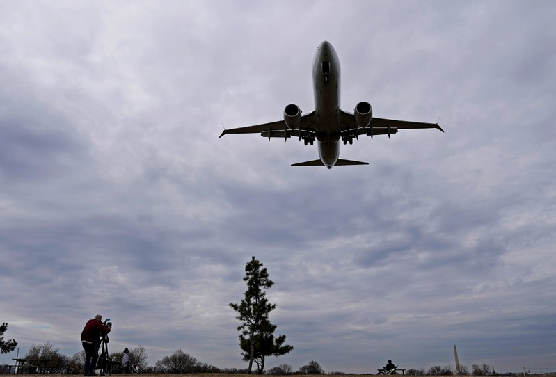 FILE PHOTO: An American Airlines Boeing 737 MAX 8 flight approaches for landing at Reagan National Airport in Washington