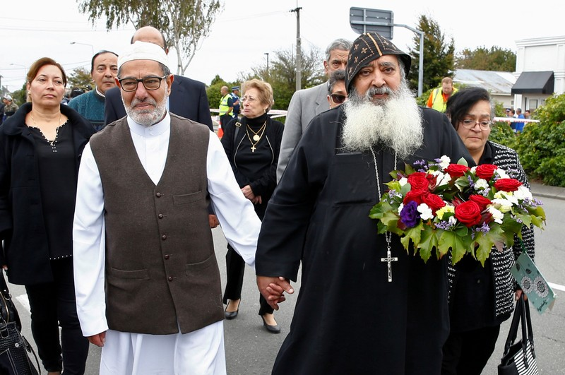 FILE PHOTO: Imam Ibrahim Abdelhalim of the Linwood Mosque holds hands with Father Felimoun El-Baramoussy from the Dunedin Coptic Church, as they walk at the site of Friday's shooting outside the Mosque in Christchurch