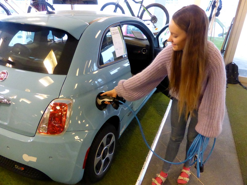 Skram of Buddy Electric car dealer company shows the charging of a second-hand Fiat 500e in Oslo