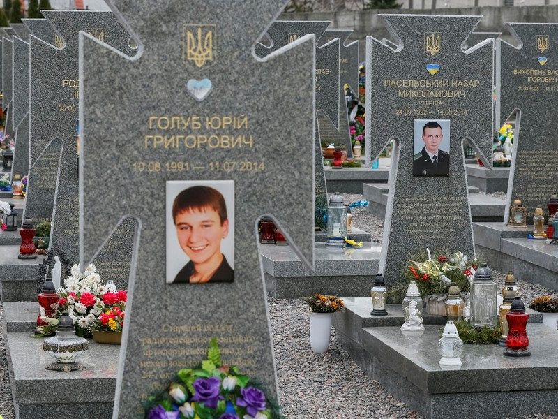 Graves of Ukrainian Army members Holub and Paselsky who were killed in the east, are seen at a 18th century Lychakiv cemetery in Lviv