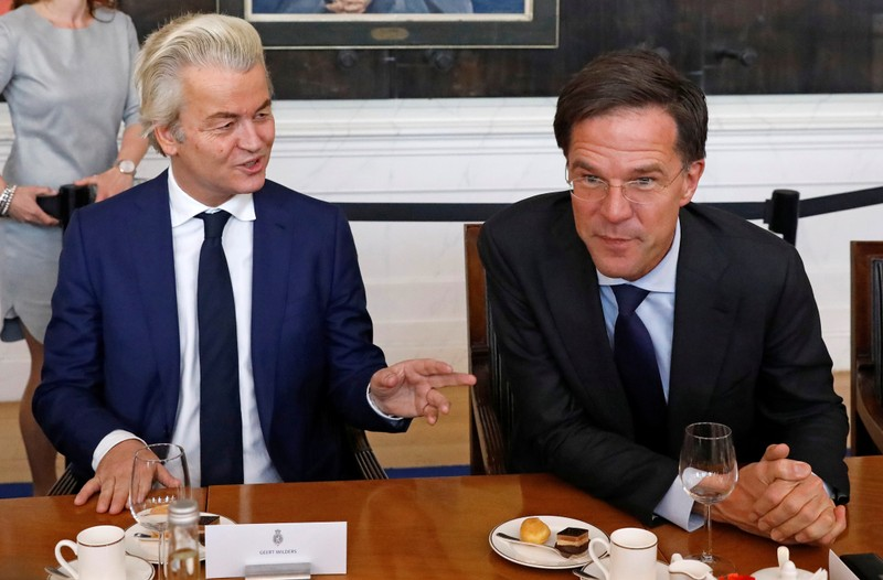 Dutch Prime Minister Rutte of the VVD Liberal party and Dutch far-right politician Wilders of the PVV Party take part in a meeting at the Dutch Parliament after the general election in The Hague
