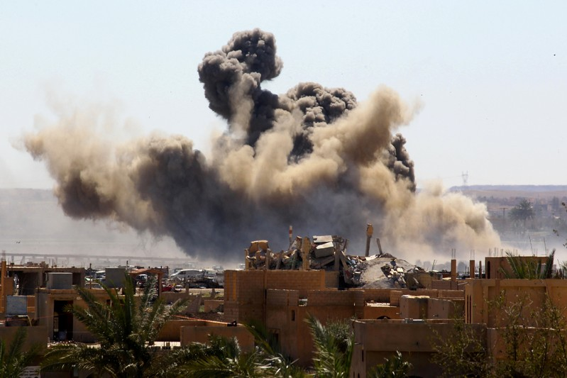 FILE PHOTO: Smoke rises from the last besieged neighborhood in the village of Baghouz, Deir Al Zor province