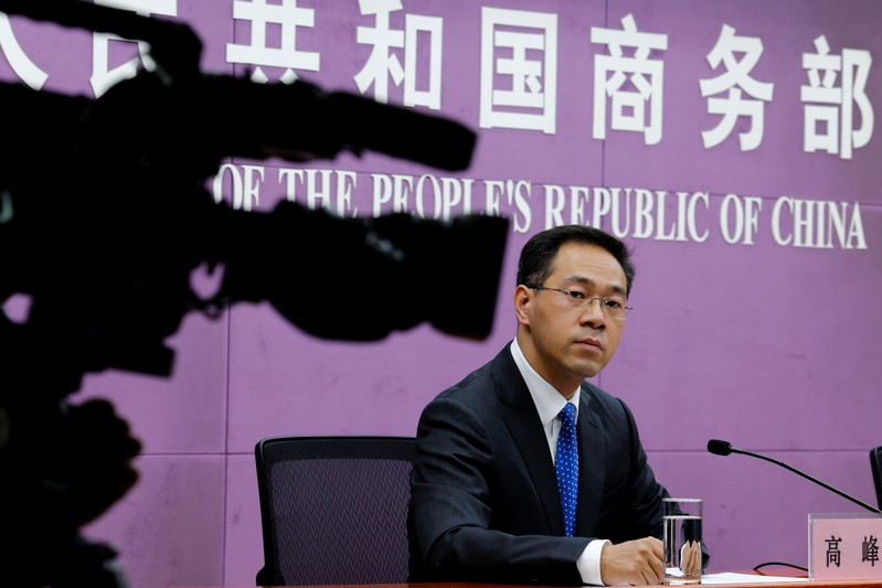 FILE PHOTO: China's Ministry of Commerce spokesperson Gao Feng attends a news conference at the commerce ministry in Beijing