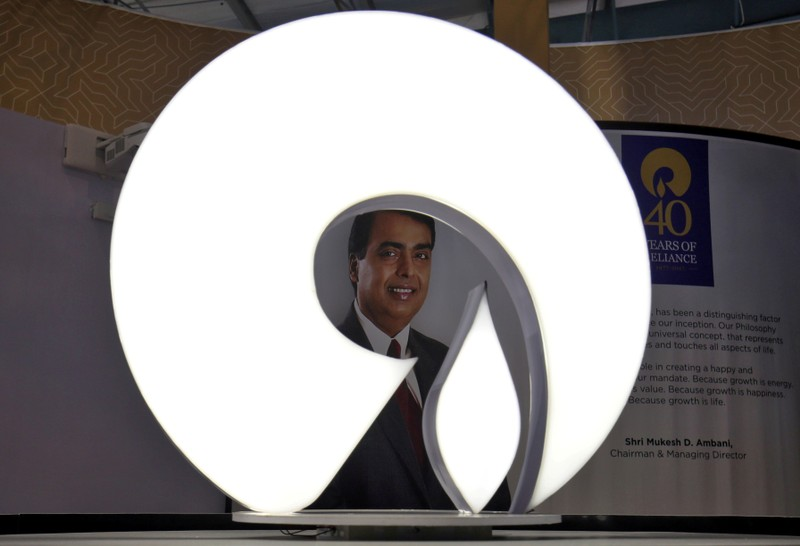 FILE PHOTO: The logo of Reliance Industries is pictured in a stall at the Vibrant Gujarat Global Trade Show at Gandhinagar