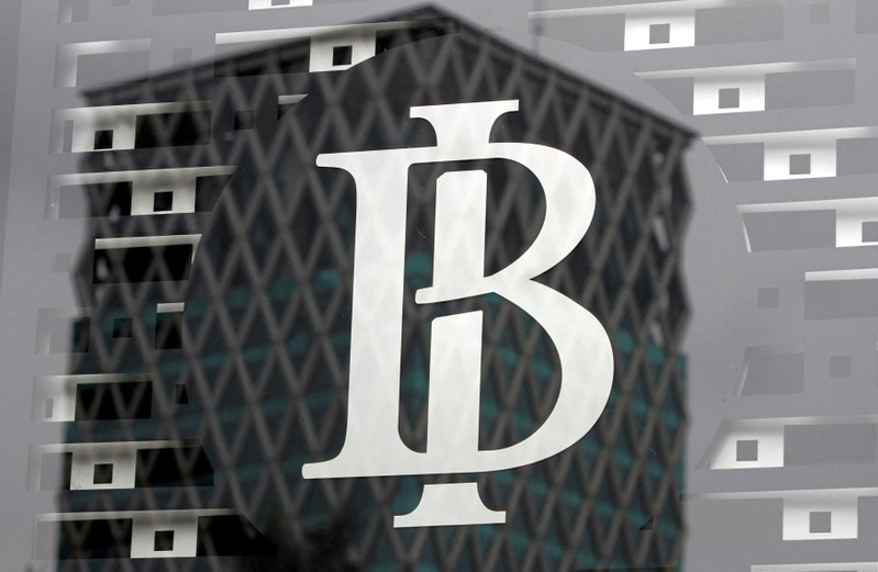 FILE PHOTO: The logo of Indonesia's central bank, Bank Indonesia, is seen on a window in the bank's lobby in Jakarta