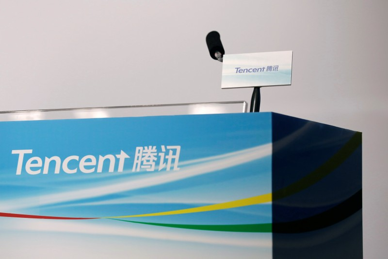 Logos of Tencent are displayed at a news conference in Hong Kong, China