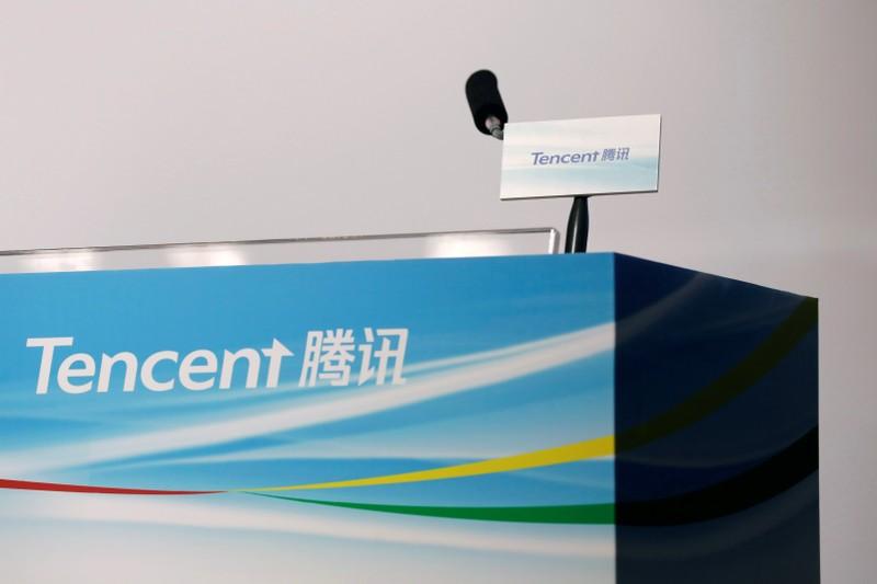 Logos of Tencent are displayed at a news conference in Hong Kong, China