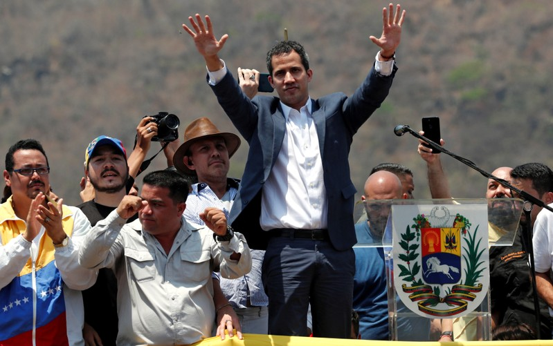 FILE PHOTO: Venezuelan opposition leader Juan Guaido, who many nations have recognised as the country's rightful interim ruler, takes part in a rally against President Nicolas Maduro's government in Valencia, Venezuela