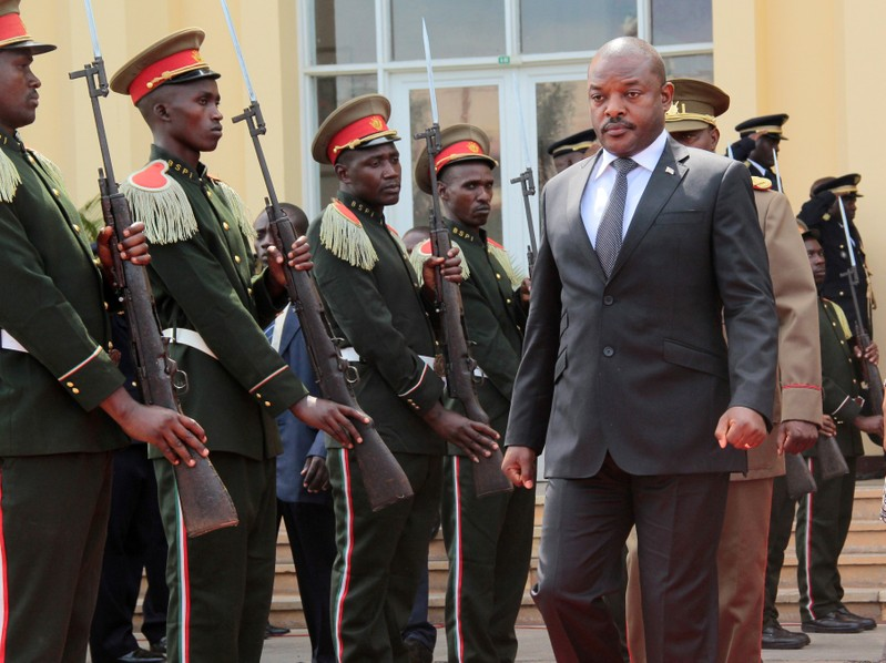 FILE PHOTO: Burundi's President Pierre Nkurunziza walks during a ceremony in tribute to the former late President Colonel Jean-Baptiste Bagaza at the national congress palace in Bujumbura, Burundi