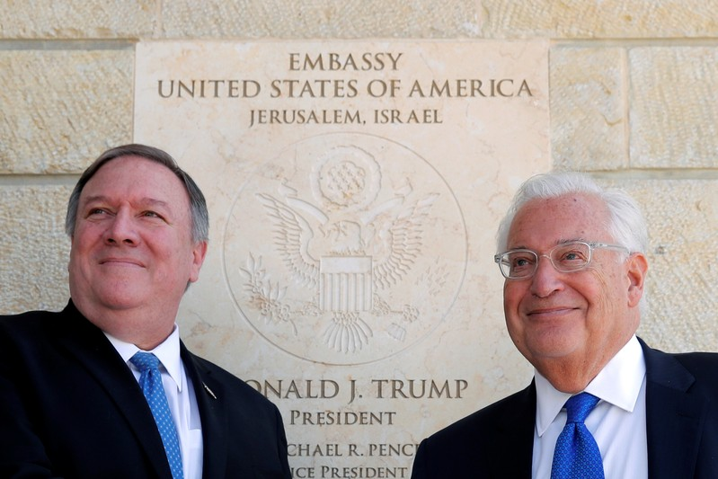 U.S. Secretary of State Mike Pompeo and U.S. Ambassador to Israel David Friedman stand next to the dedication plaque at the U.S. embassy in Jerusalem