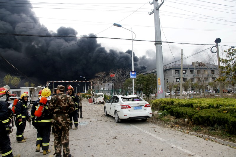 Rescue workers are seen near smoke following an explosion at a chemical industrial park in Xiangshui