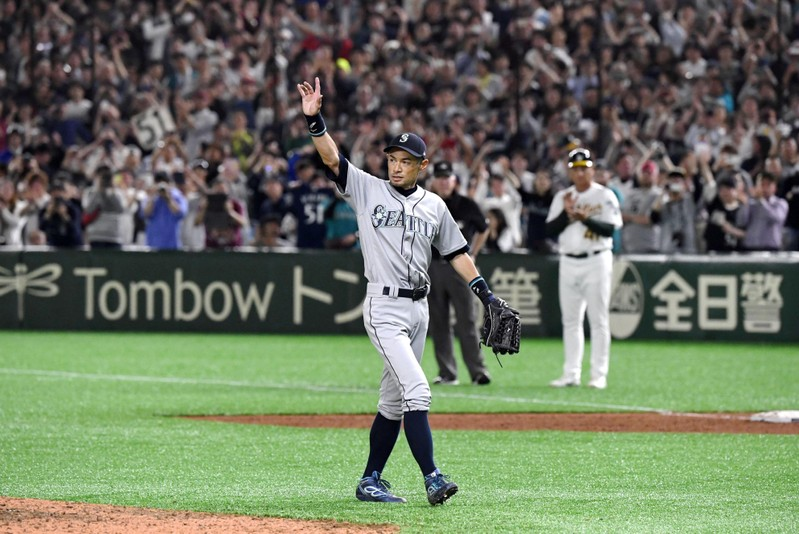 Seattle Mariners right fielder Ichiro Suzuki acknowledges to fans as he leaves the field in the bottom of eighth inning during the game against the Oakland Athletics in Tokyo