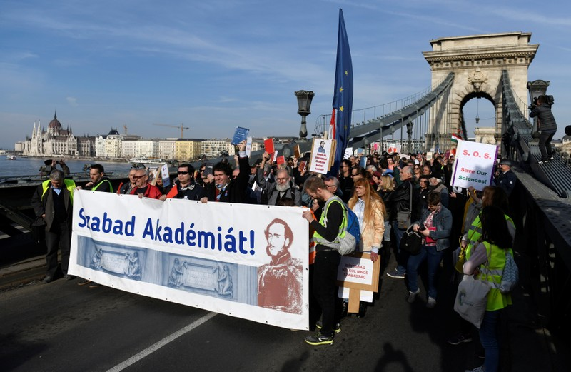 People take part in a protest against government's plans to overhaul the Hungarian Academy of Sciences, on the Chain Bridge in Budapest.