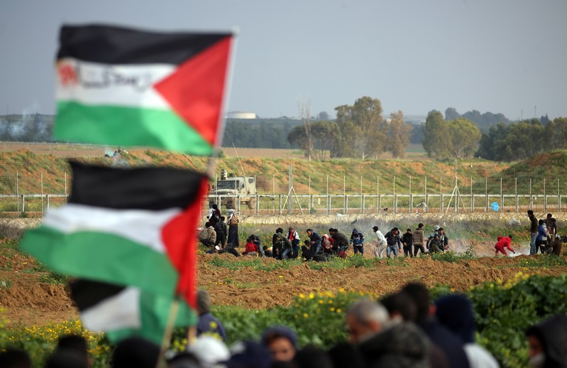 Palestinian demonstrators protest at the Israel-Gaza border fence, in the southern Gaza Strip