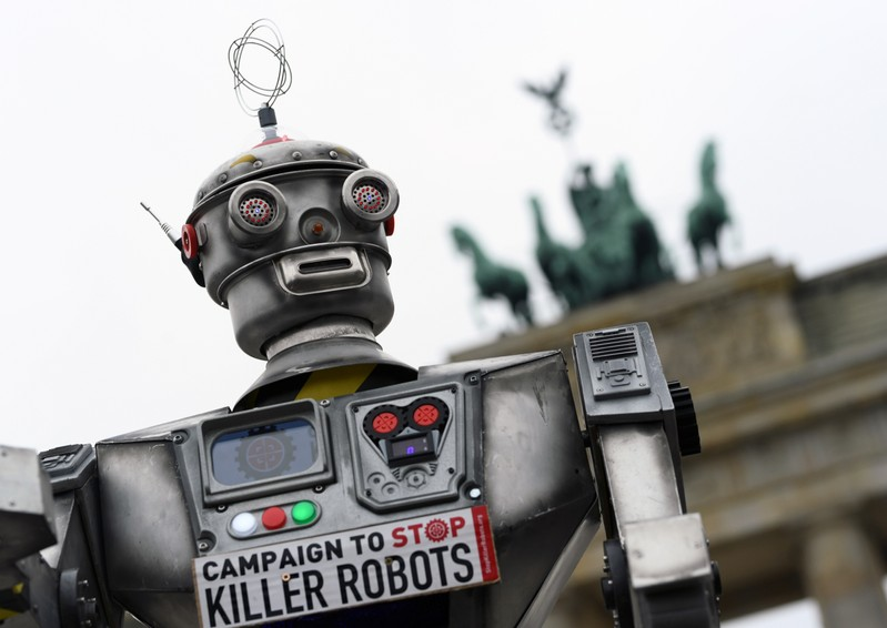 Activists from the Campaign to Stop Killer Robots, a coalition of non-governmental organisations opposing lethal autonomous weapons or so-called 'killer robots', stage a protest at Brandenburg Gate in Berlin