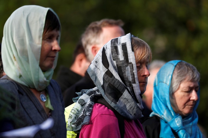 Women attend a vigil for the victims of the mosque attacks during an ecumenical celebration in Christchurch