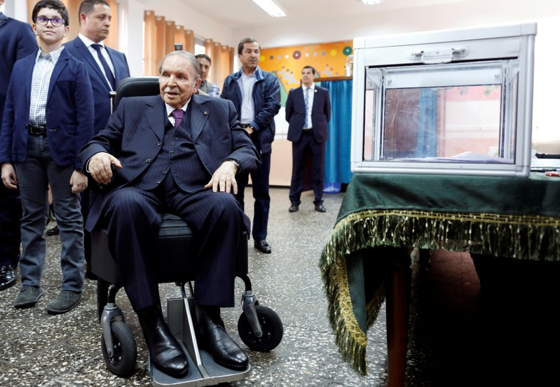 FILE PHOTO: Algeria's President Abdelaziz Bouteflika looks at journalists after casting his ballot during the parliamentary election in Algiers