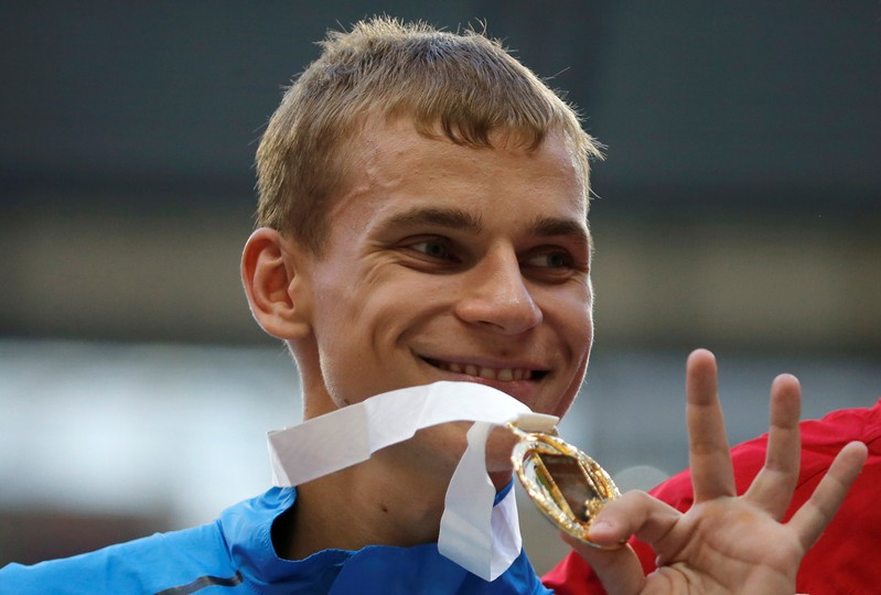 Gold medallist Ivanov of Russia poses during the award ceremony for the men's 20 km race walk final during the IAAF World Athletics Championships at the Luzhniki stadium in Moscow