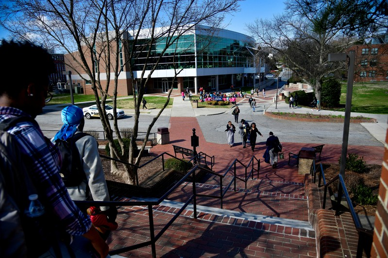 Students walk between classes at North Carolina A&T University just to the west of the line that divides Congressional Districts 13 and 6 on campus in Greensboro