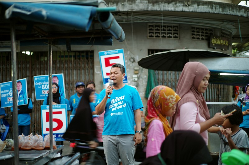 Democrat Party's candidate Anwar Salae campaigns at a market in Pattani province