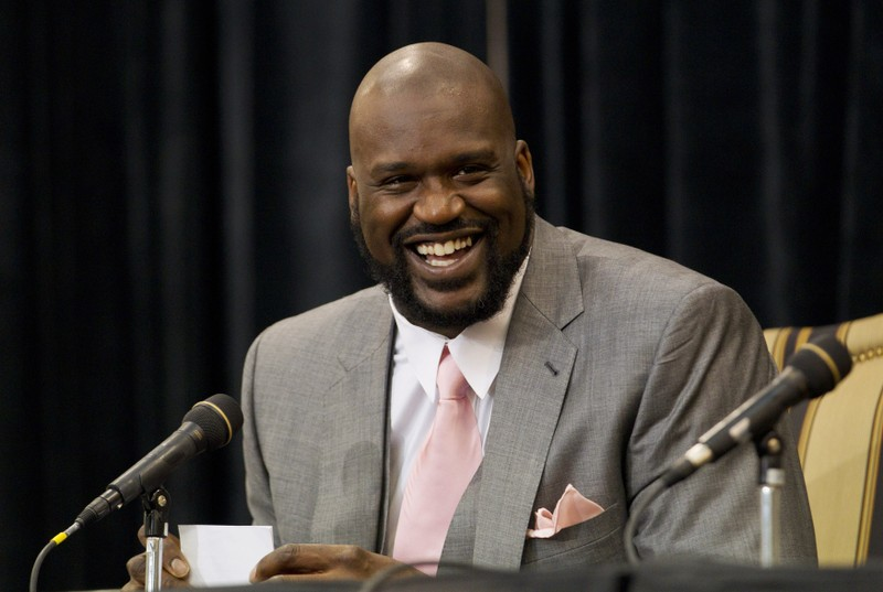 Shaquille O'Neal laughs as he announces his retirement from NBA at a news conference in Windermere