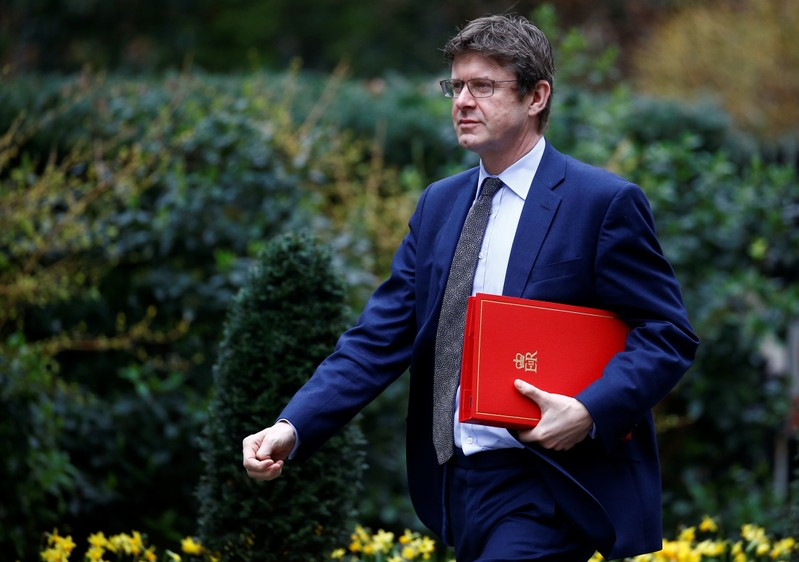 Britain's Secretary of State for Business Greg Clark walks outside Downing Street in London