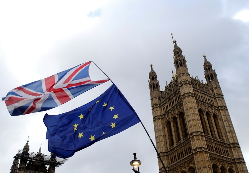 FILE PHOTO: Flags flutter outside the Houses of Parliament in London