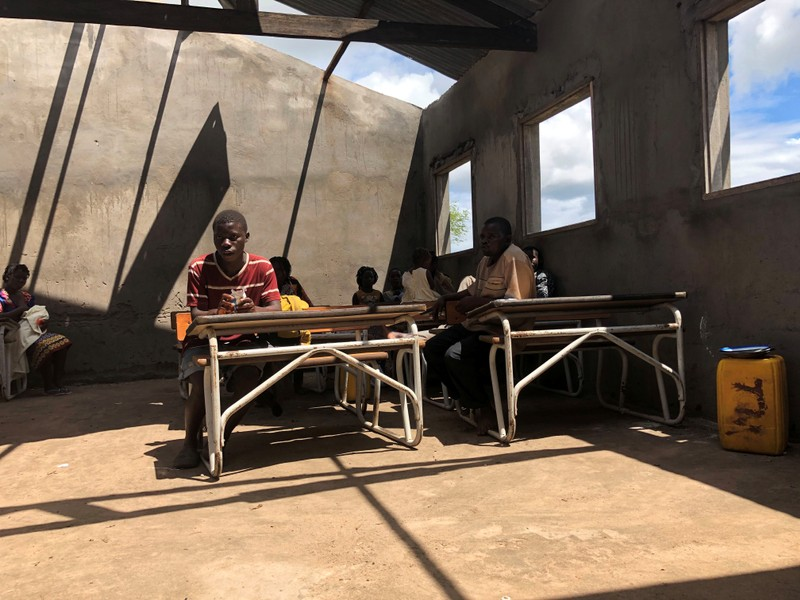 People take shelter after Cyclone Idai in a secondary school in Guara Guara outside Beira