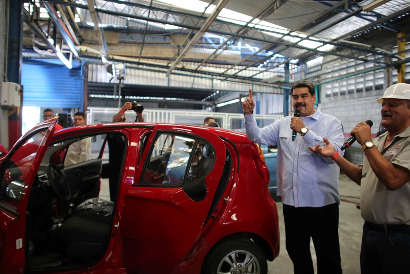 Venezuela's President Nicolas Maduro speaks during his visit to a vehicle production plant in Las Tejerias
