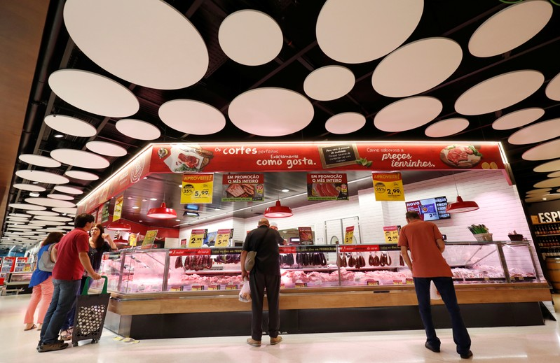 FILE PHOTO: Consumers wait to buy meat products at a Pingo Doce supermarket in Lisbon