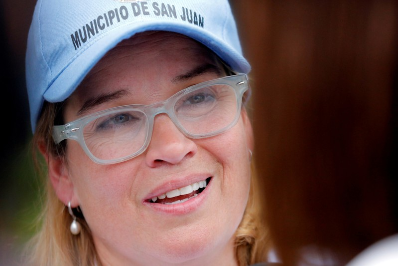 FILE PHOTO: Mayor of San Juan Carmen Yulin Cruz talks with journalists outside the government center at the Roberto Clemente Coliseum days after Hurricane Maria, in San Juan