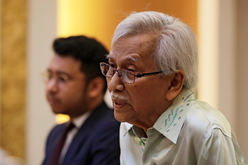 Malaysia's new government advisor Daim Zainuddin speaks during a meeting with Chinese Foreign Minister Wang Yi at the Ministry of Foreign Affairs in Beijing