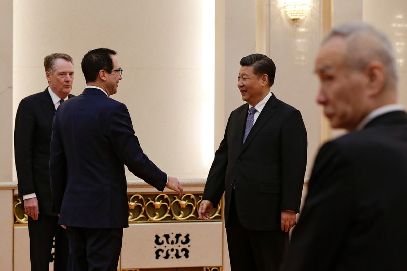 U.S. Treasury Secretary Steven Mnuchin talks with Chinese President Xi Jinping in Beijing