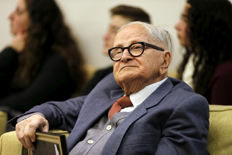 FILE PHOTO: Eitan, who was involved in the capture of Eichmann, an architect of the Nazi Holocaust, sits during a ceremony at Israeli President Rivlin's residence in Jerusalem