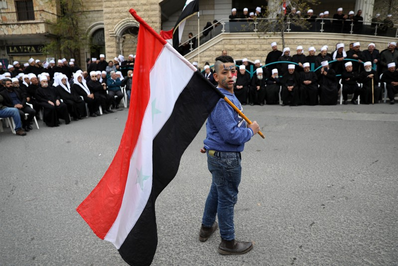 Druze people take part in a rally over U.S. President Donald Trump's support for Israeli sovereignty over the Golan Heights, in Majdal Shams near the ceasefire line between Israel and Syria in the Israeli occupied Golan Heights
