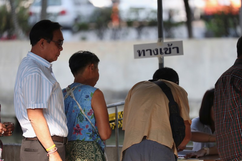 Thailand's Prime Minister Prayuth Chan-ocha prepares to vote in the general election at a polling station in Bangkok