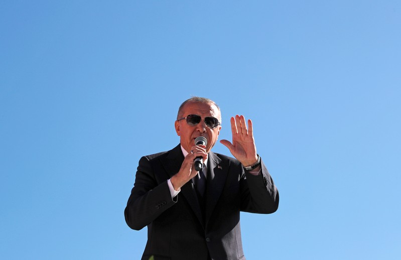 Turkish President Tayyip Erdogan addresses supporters during a rally for the upcoming local elections, in Istanbul