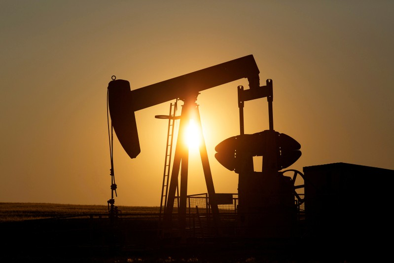 FILE PHOTO: FILE PHOTO: An oil pump jack pumps oil in a field near Calgary
