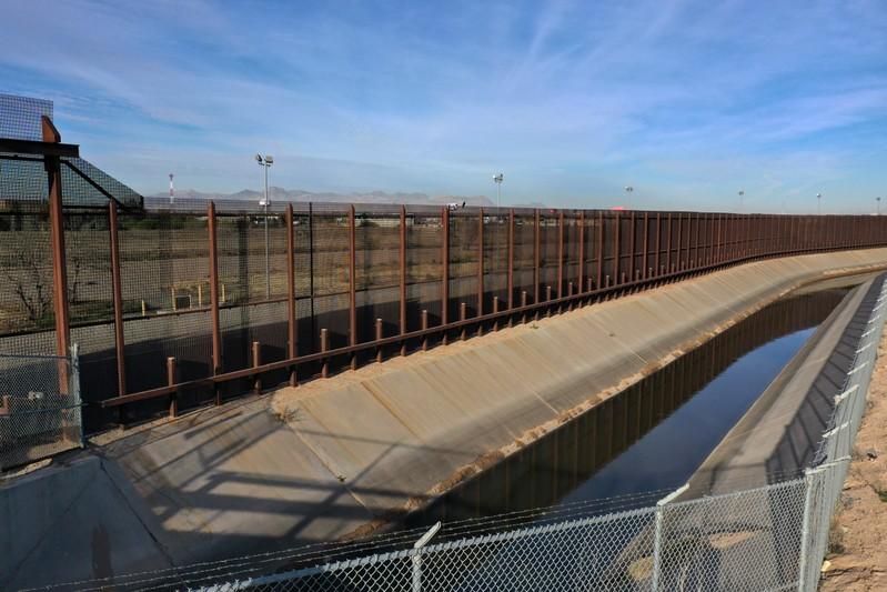 The U.S.-Mexico border fence is seen in El Paso