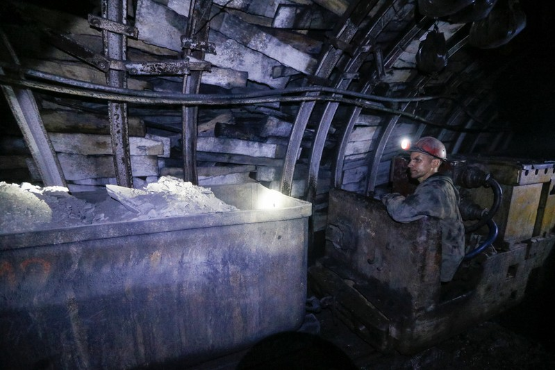 A miner works inside the Novovolynska-9 coal mine in Novovolynsk