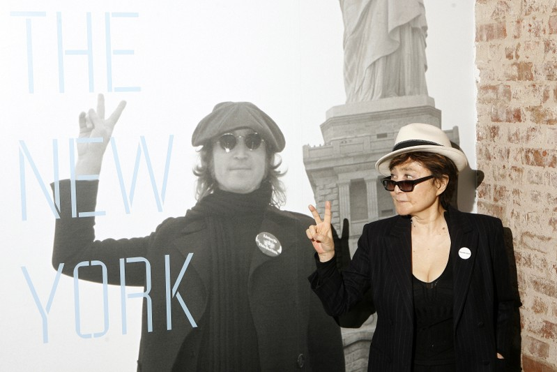 FILE PHOTO: Yoko Ono gestures as she unveils the