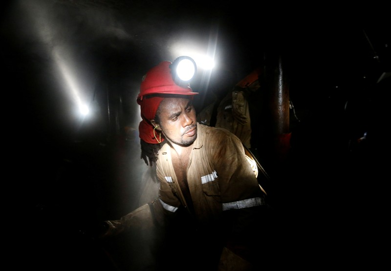 FILE PHOTO: Miner works deep underground at Sibanye Gold's Masimthembe shaft in Westonaria