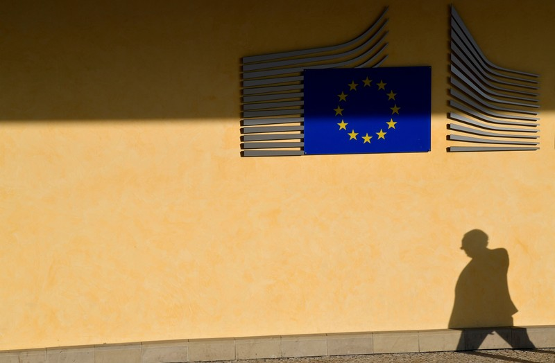 FILE PHOTO: The shadow of a worker is seen beside the EU Commission building in Brussels, Belgium