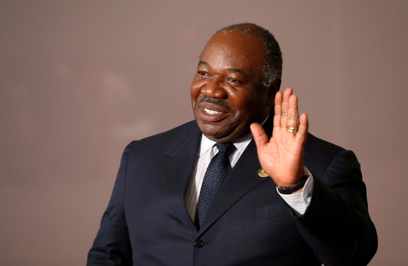 FILE PHOTO: Gabonese President Ali Bongo Ondimba arrives for a group picture at the BRICS summit meeting in Johannesburg