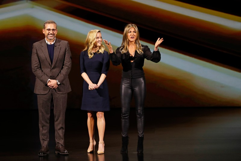 Actors Steve Carrell, Reese Witherspoon and Jennifer Aniston speak during an Apple special event at the Steve Jobs Theater in Cupertino