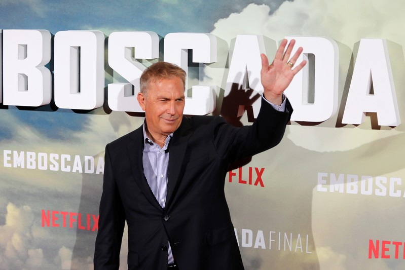 Actor Costner waves during a photocall to promote his latest film