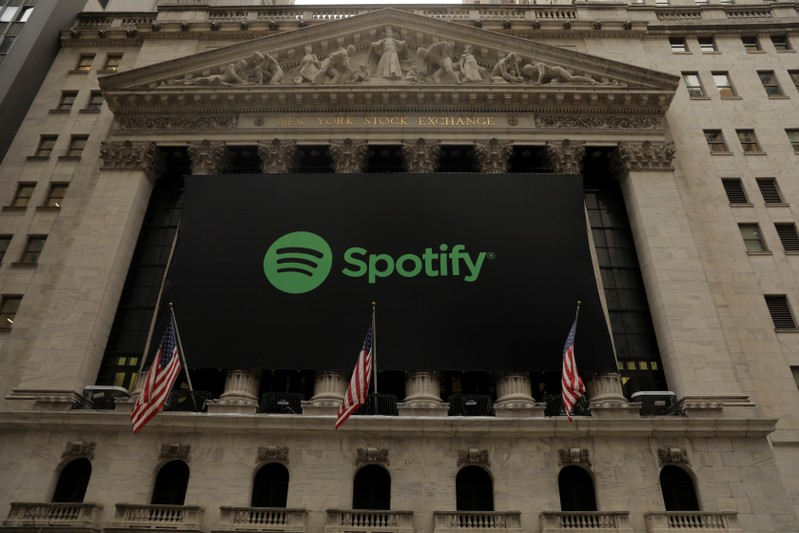 The Spotify logo hangs on the facade of the New York Stock Exchange as the company lists its stock with a direct listing in New York